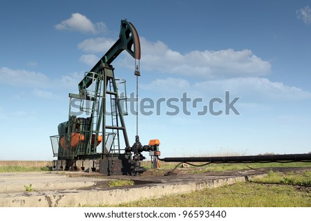 oil industry pumpjack - stock photo