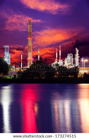 Oil industry refinery factory with dramatic sky. - stock photo