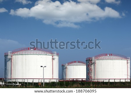 oil industry refinery tanks on field - stock photo