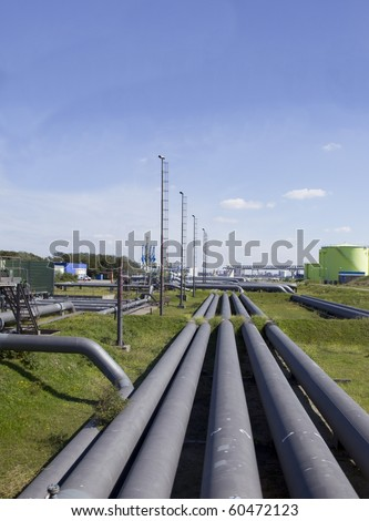 Oil industry with pipes and tubes all over. - stock photo