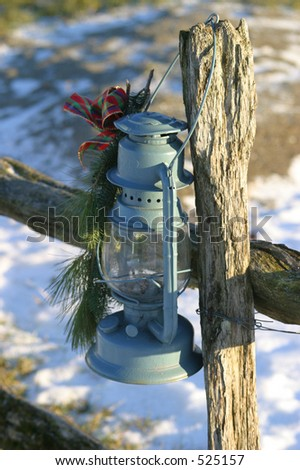 Oil Lamp Hung on Wood Rail Post - stock photo