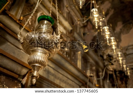 Oil lamp in Greek Orthodox Church - stock photo