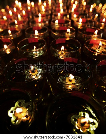 Oil lamps are on display at a Buddhist temple. - stock photo