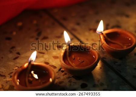 oil lamps lit on diwali festival - stock photo