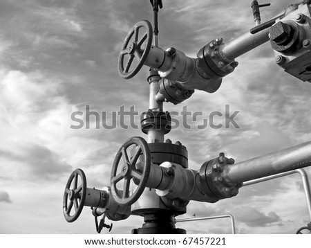 Oil latch on a pipeline. Black and white photo - stock photo