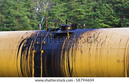 oil leking from tank on railroad - stock photo