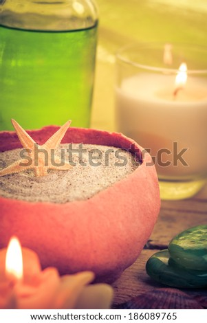 Oil massage with aromatic candles and stones Zen - stock photo