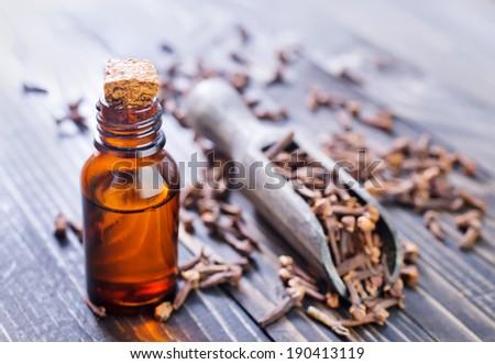 Oil of cloves in a glass bottle - stock photo