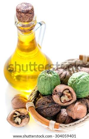 Oil of the walnut. Walnuts in the basket. - stock photo