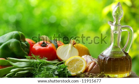 Oil Olive with vegetables and condiments. - stock photo