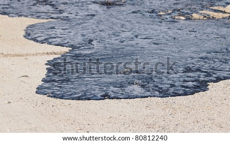 Oil on beach - stock photo