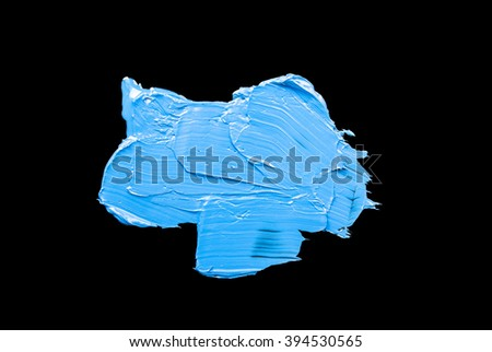 Oil paint brush strokes isolated over the black background