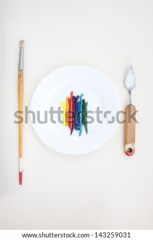 oil paint served like a dish with vintage painting instruments - stock photo