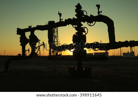 Oil pipeline and equipment in the sunset, closeup of photo