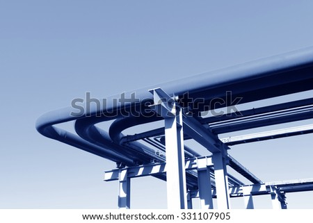 Oil pipeline close-up, under the blue sky