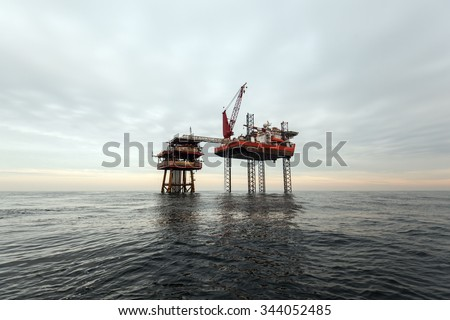 Oil platform at cloudy day - stock photo