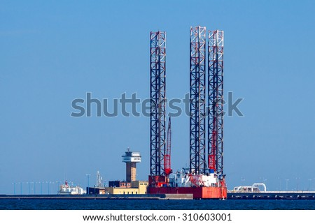 Oil platform for the extraction of hydrocarbons from the seafloor. - stock photo