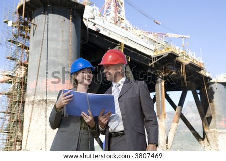 Oil platform inspectors - stock photo