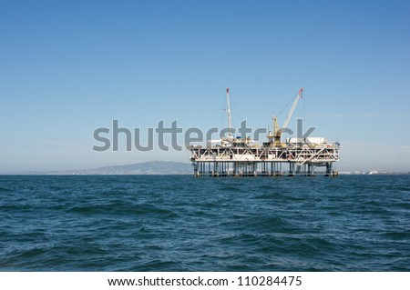 Oil platform off the shore of Southern California - stock photo