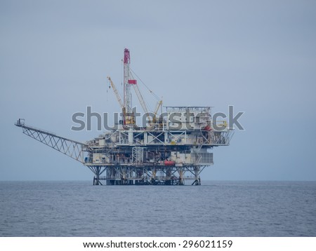 Oil platform producing from the Dos Cuadras Field eight miles southeast of Santa Barbara, California - stock photo