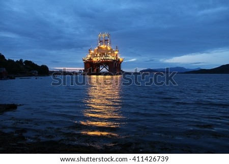 Oil platform under construction in a fiord in Norway. - stock photo