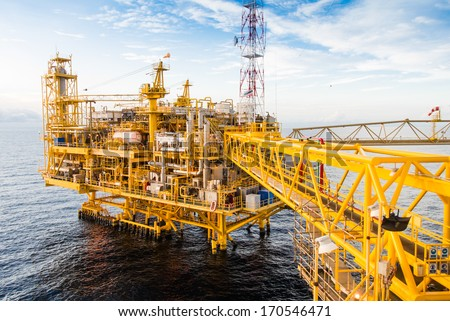 Oil platform yellow color in the sea - stock photo