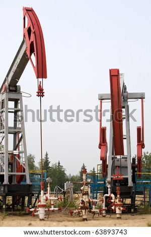 oil production equipment, closeup of pumps, Lukoil company in Russia - stock photo