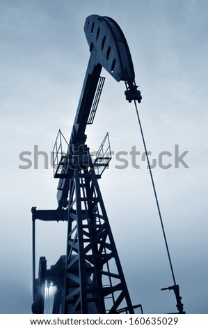Oil pump in the orange sunset, taken in the luanhe river south excrementum bombycis mouth, in the north of China   - stock photo