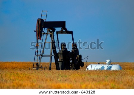Oil Pump in Wheat Field