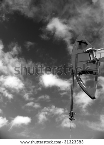 Oil pump jack in work. Oil industry in West Siberia. Siberian frost in sunny day.  Black and white photo - stock photo