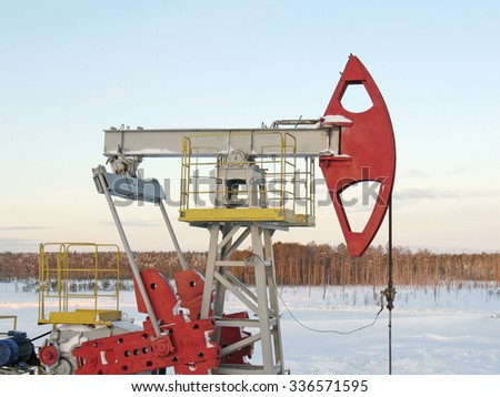 Oil pump jack. Oil industry in West Siberia. Winter frost - stock photo