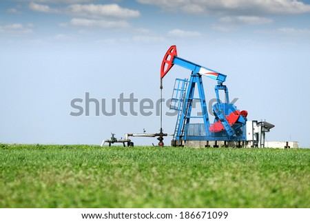 oil pump jack on oilfield - stock photo