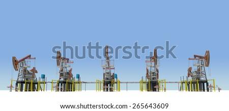 Oil pump-jacks on white plane. Front view. Blue sky as backdrop - stock photo