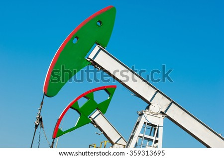 oil pump. Oil industry equipment. filtered picture of oil pump jack. Oil and gas industry. Work of oil pump jack on a oil field. - stock photo
