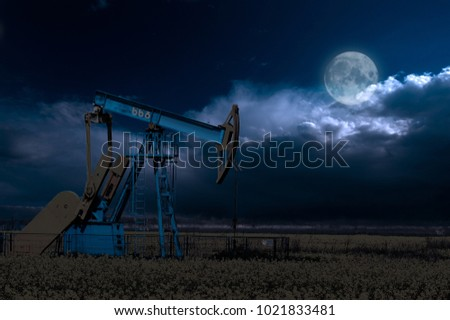 Oil pump oil rig energy industrial machine for petroleum in the night