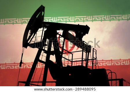 Oil pump on background of flag of Iran - stock photo
