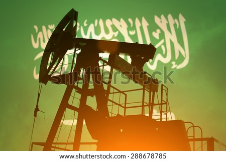 Oil pump on background of flag of Saudi Arabia - stock photo