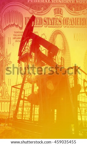 Oil pump on background of US  10000 dollar. Oil and gas industry. Work of oil pump jack on a oil field. White clouds and blue sky. oil well pump. Oil and gas industry.  - stock photo
