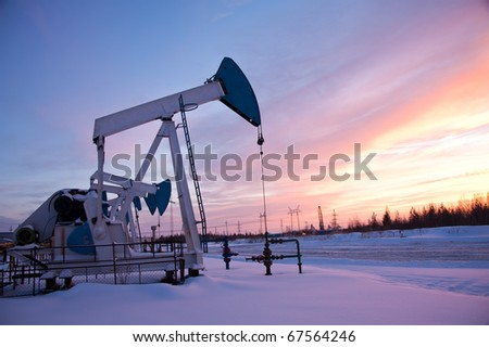 oil pump on the sunset sky background - stock photo