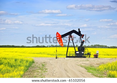 Oil pumpjack or nodding horse pumping unit in Saskatchewan prairies, Canada - stock photo