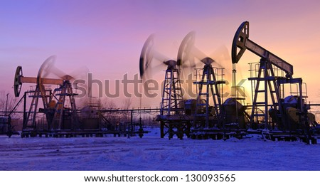 oil pumps at sunset sky background. panorama. - stock photo