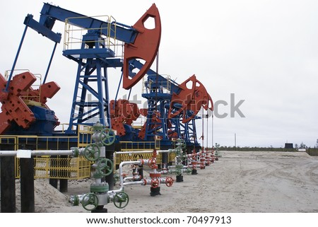 Oil pumps extracting oil - stock photo