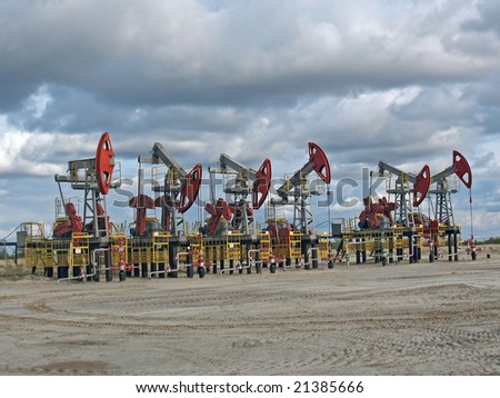 Oil pumps in west Siberia. - stock photo