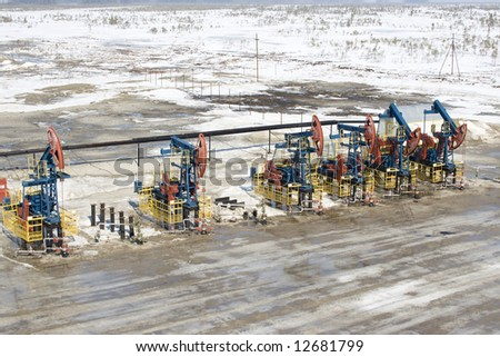 Oil pumps in West Siberia. Oil industry equipment - stock photo