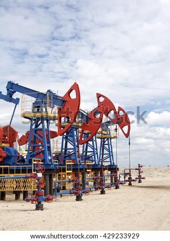 Oil pumps jack - stock photo