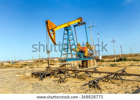 Oil pumps. Oil industry equipment - stock photo