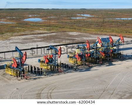 Oil pumps on a swamp. - stock photo