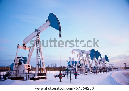 oil pumps on the sunset sky background - stock photo