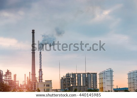 Oil refineries in the sunset sky background
