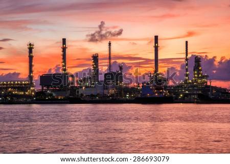 Oil refinery along the river at Dusk (Bangkok, Thailand) - stock photo